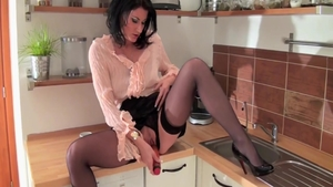 Hawt MILF masturbating in the kitchen
