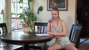 Solo skinny Lily Rader female playing with toys
